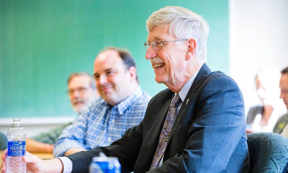 Francis Collins at a conference room table
