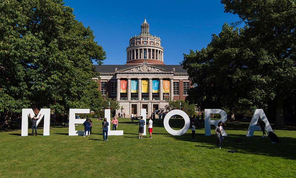 MELIORA in large letters in front of Rush Rhees Library