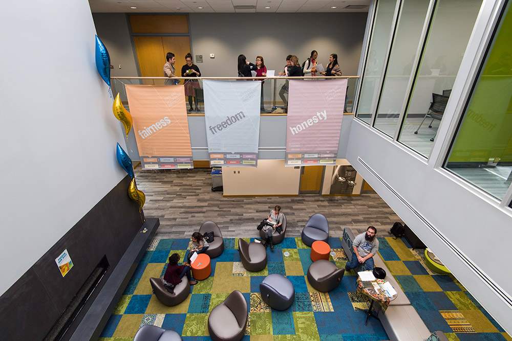 overhead photo of students gathering in the Language Center