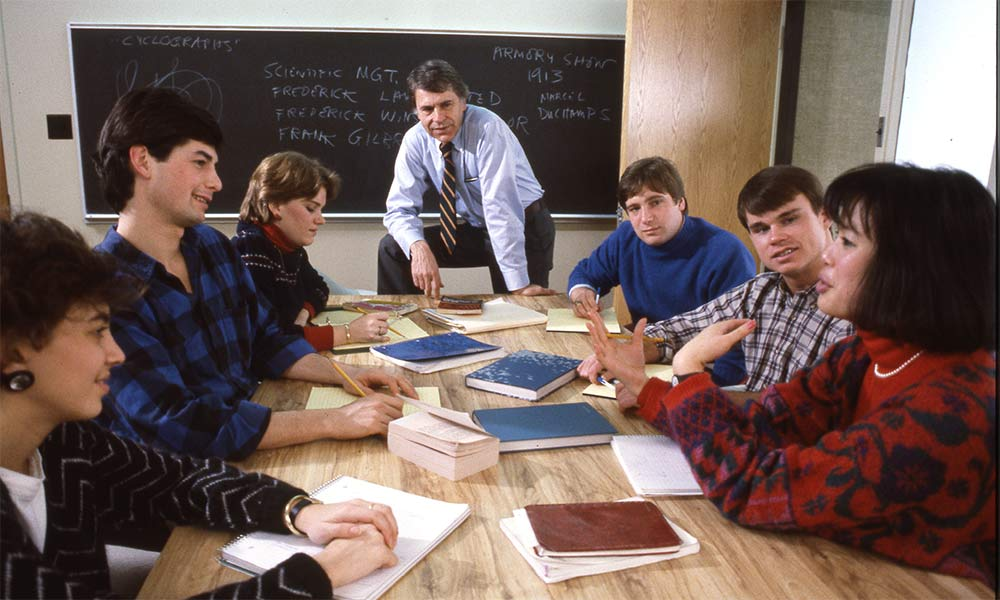 students and teacher around a table