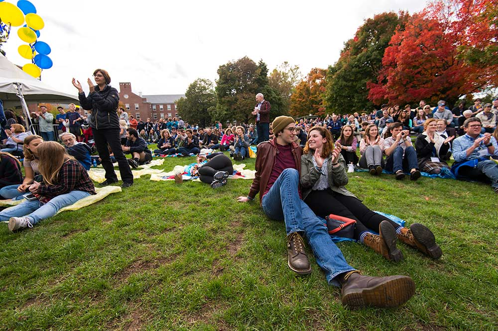 people sitting on the quad listening to a concert