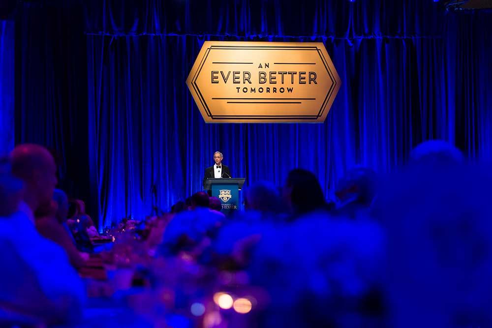 Joel Seligman on stage at dinner