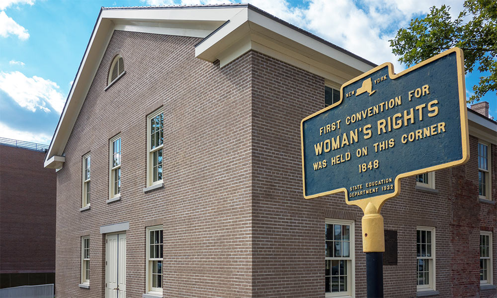 """old church with historical monument reading """"First Convention for Woman's Rights was held on this corner"""""""