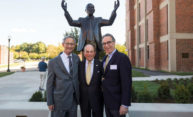 Ed Hajim '58 [center] stands with University President and CEO Joel Seligman [left] and artist Marc Mellon in front of his new statue, unveiled Oct. 7 on the Edmund A. Hajim Science & Engineering Quadrangle. (Photo by J. Adam Fenster / University Communications)