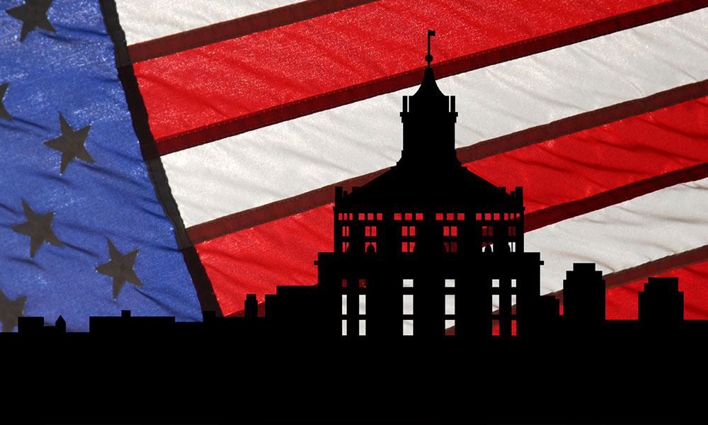 graphic of Rush Rhees Libary in front of American flag