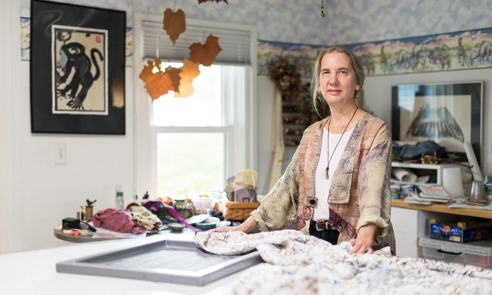 woman standing in her artist workshop