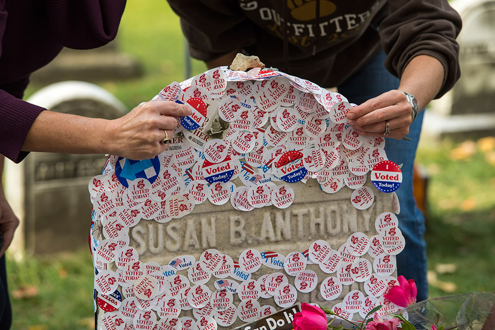 I VOTED stickers cover gravestone of Susan B. Anthony