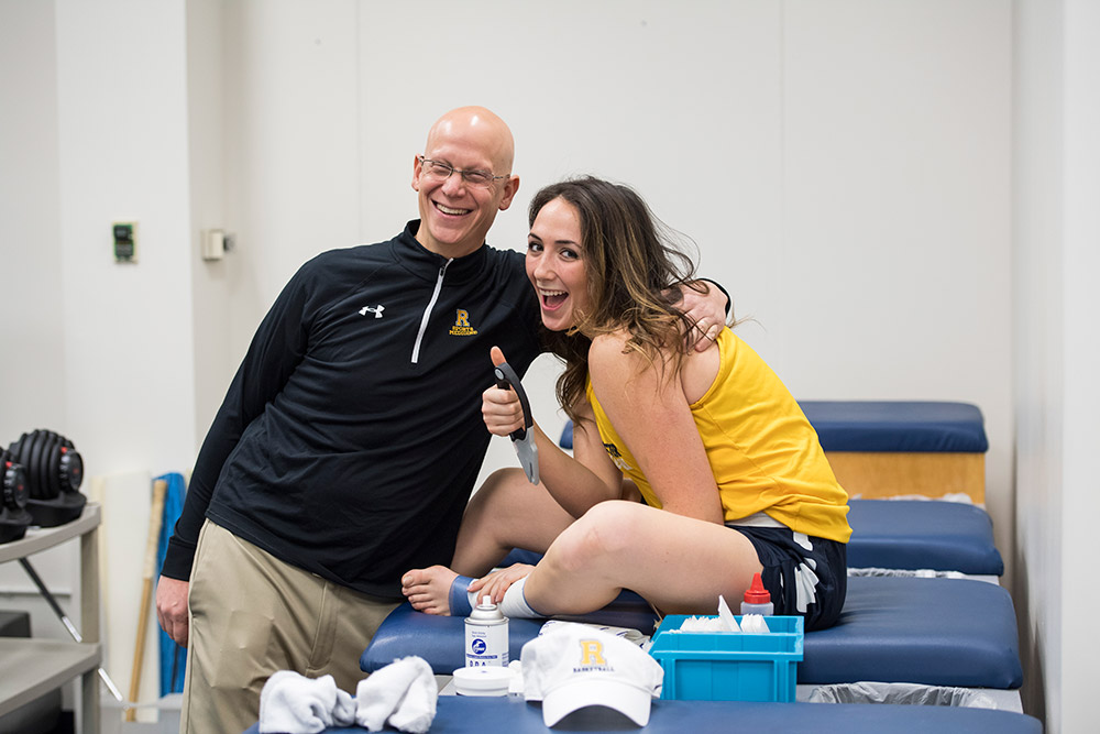 athletic trainer and student give a thumbs up