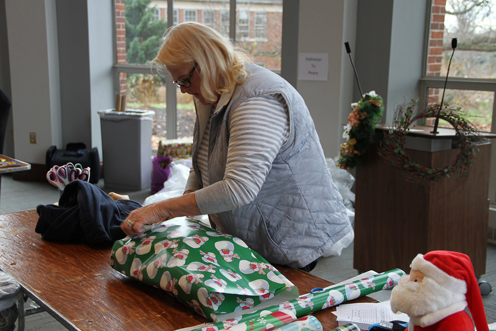 woman wrapping a present