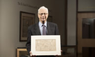 Seymour Schwartz, distinguished Alumni Professor of Surgery, holds the first map engraved in the Province of New York, part of the collection he donated to River Campus Libraries in 2010. Schwartz will share the story of his passion for cartographic history as part of the Memorial Art Gallery's Hidden Passions series. (University photo / J. Adam Fenster)