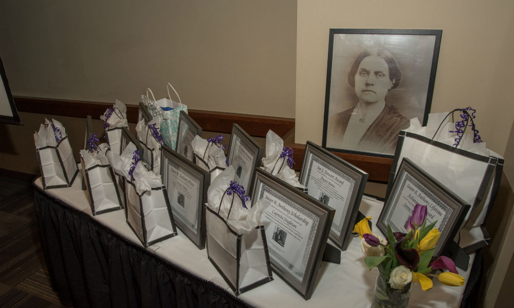 table full of awards and photo of Susan B. Anthony