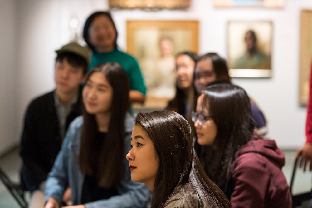 Sarah Pursell '20 listens to Andrew Cappetta, the Memorial Art Gallery's assistant curator of academic programs, during a class visit to the museum. (University photo / J. Adam Fenster)