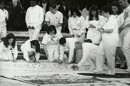 archival photo of people signing panel