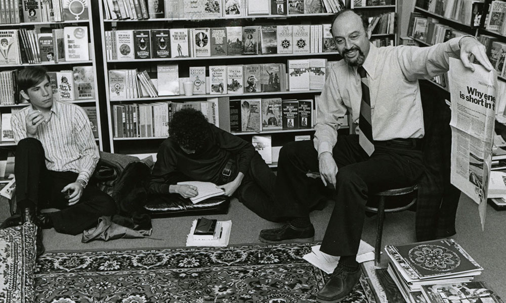 archival photo of Albert Simon teaching