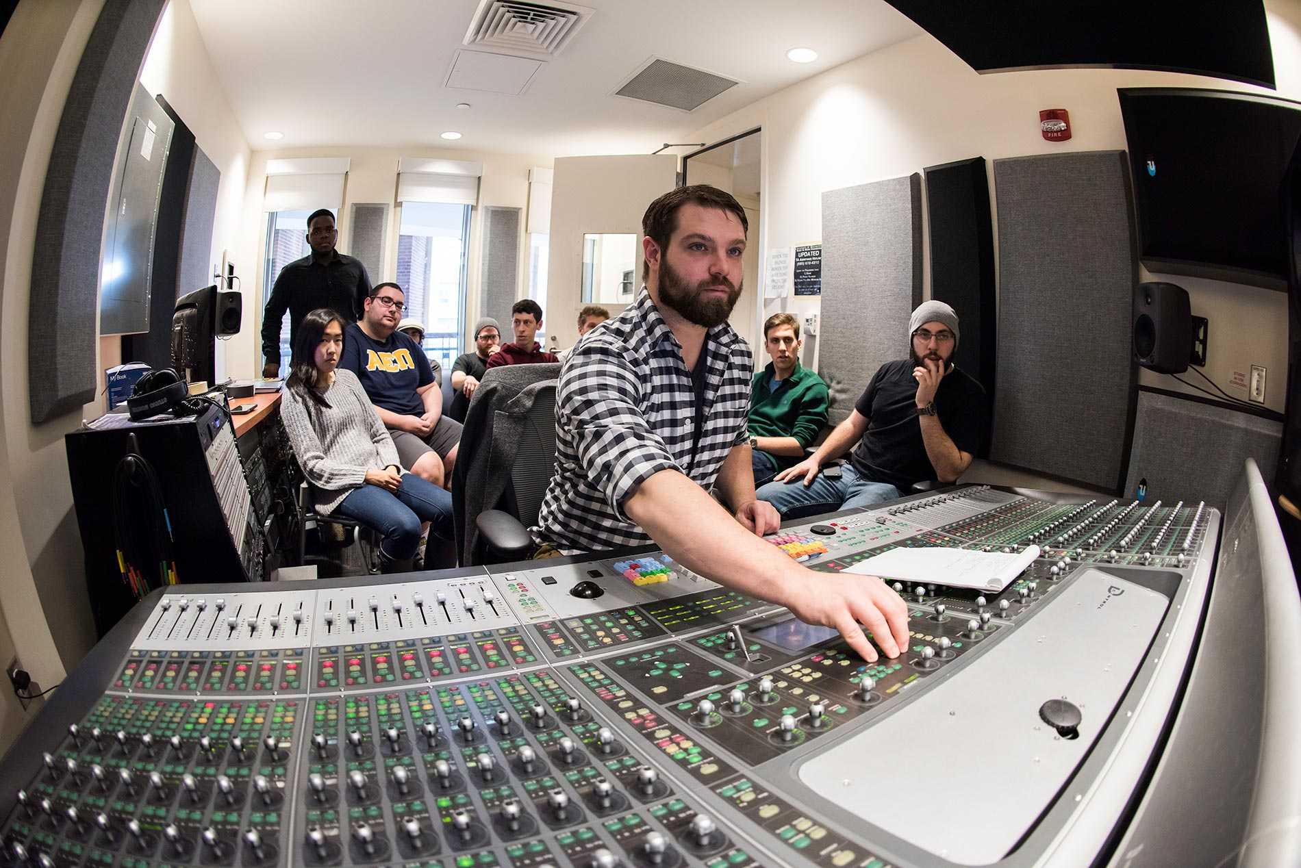 students and instructor in recording studio