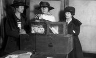 historical photo of women at ballot box