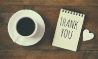 coffee cup with a notepad that says THANK You with a heart