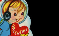 close-up of Worl War I era valentine card shows boy holding heart that says VALENTINE
