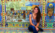 woman in front of elaborate mural