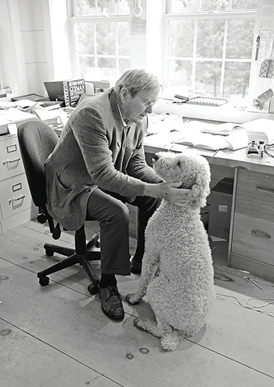Galway Kinnell in his office with his dog