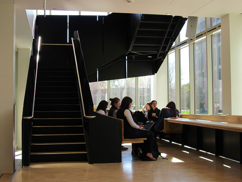 students sitting in a window seat
