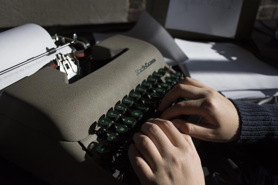 woman's hands at typewriter keyboard