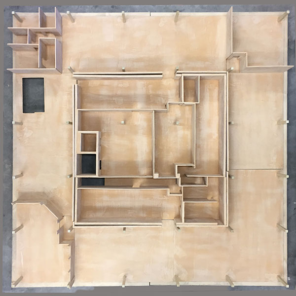 plywood replica of floor plan from Sage Art Center