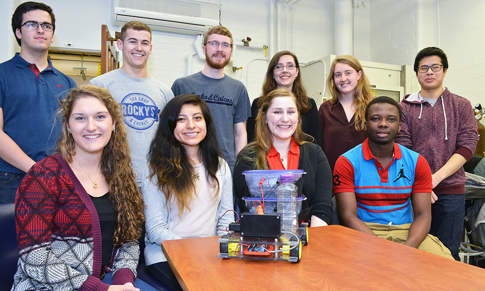 students and their chemically-powered table-top vehicle