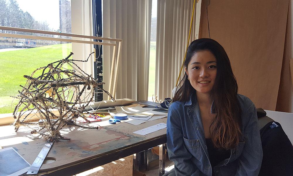 student in home art studio