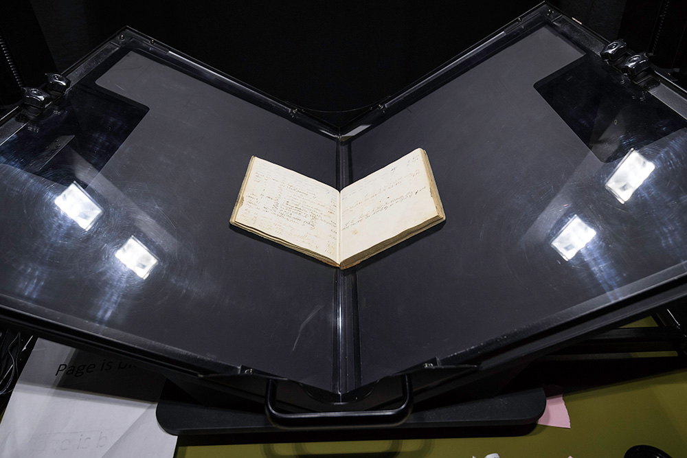 book on a stand, being digitized