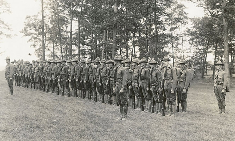 historic image of soldiers lined up to drill