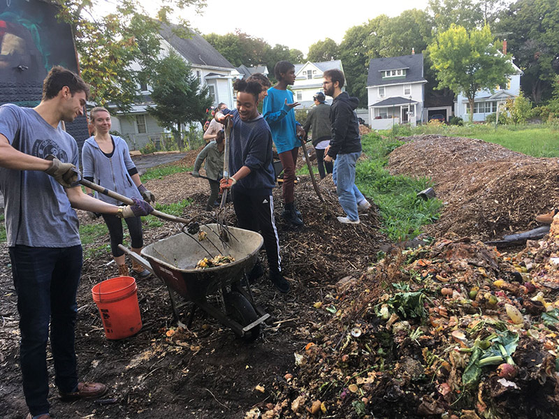 students tending compost pile