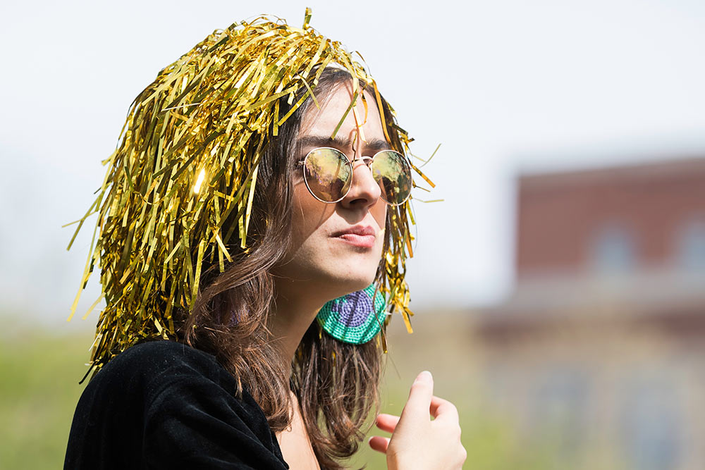 girl wearing a gold pompom on her head
