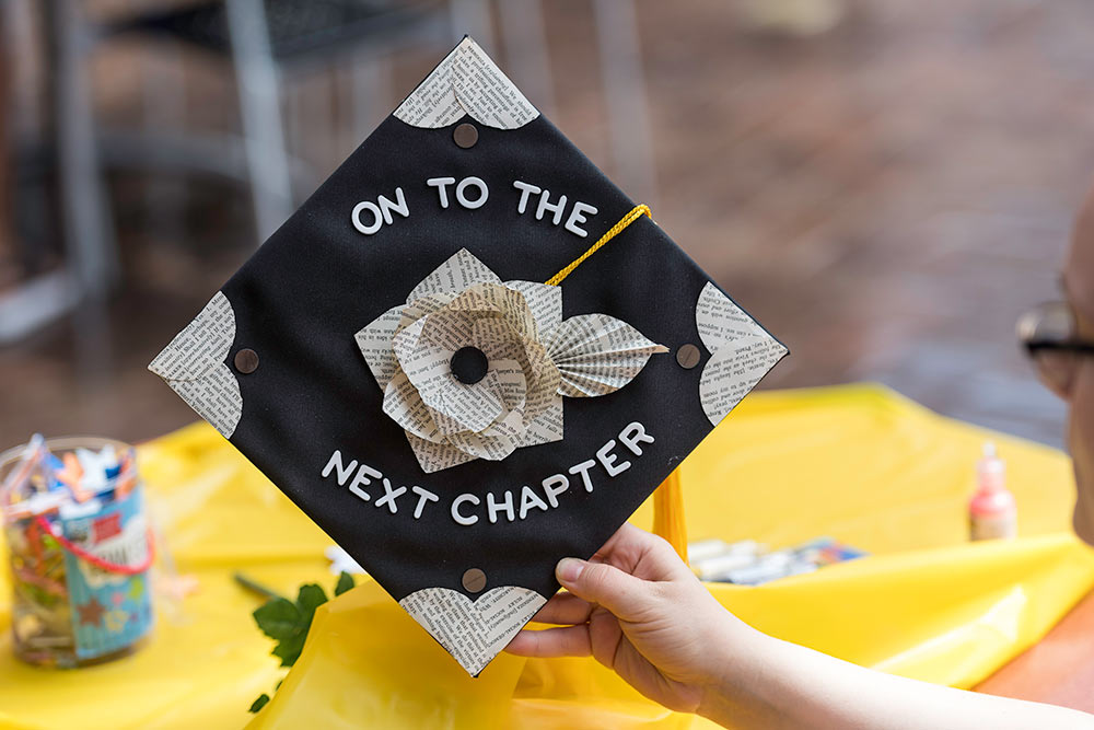 graduation cap decorated to read ON TO THE NEXT CHAPTER