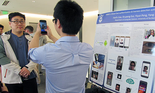 student taking photo of another student rolling his eyes