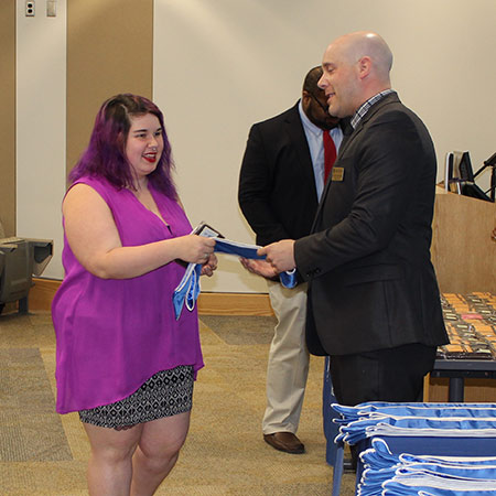 woman receiving an award from man