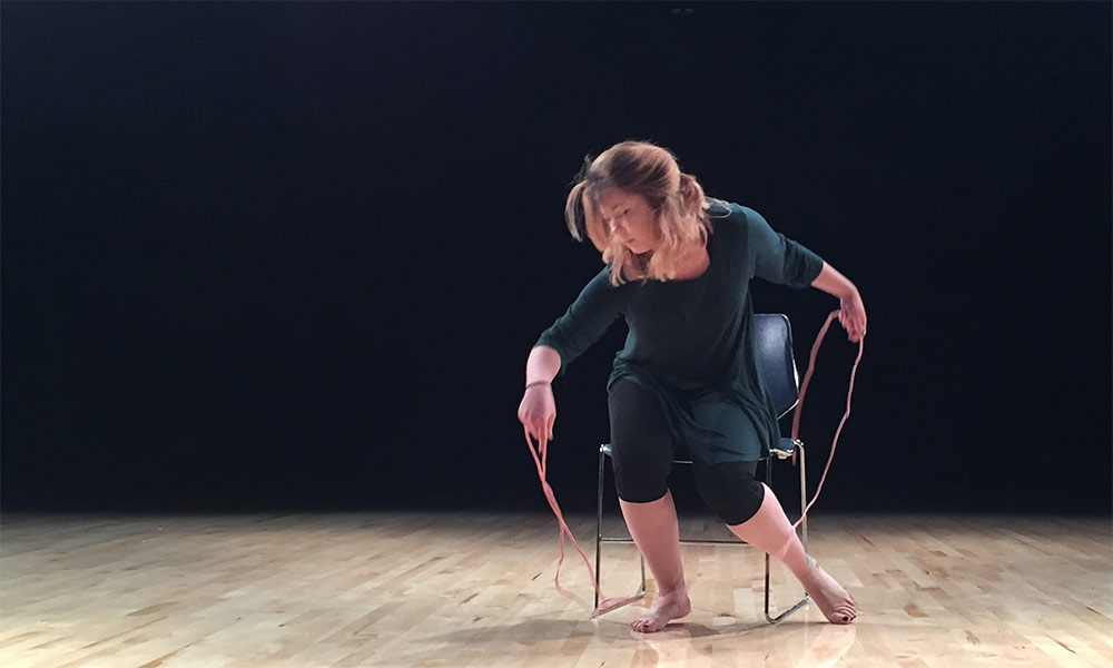 dancer on a chair on stage