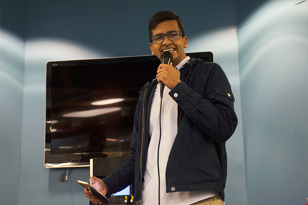 student with microphone performing standup