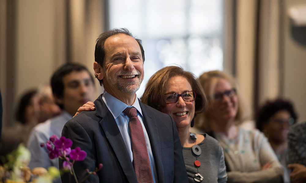 Richard Feldman and his wife Andrea smiling in a crowd of people