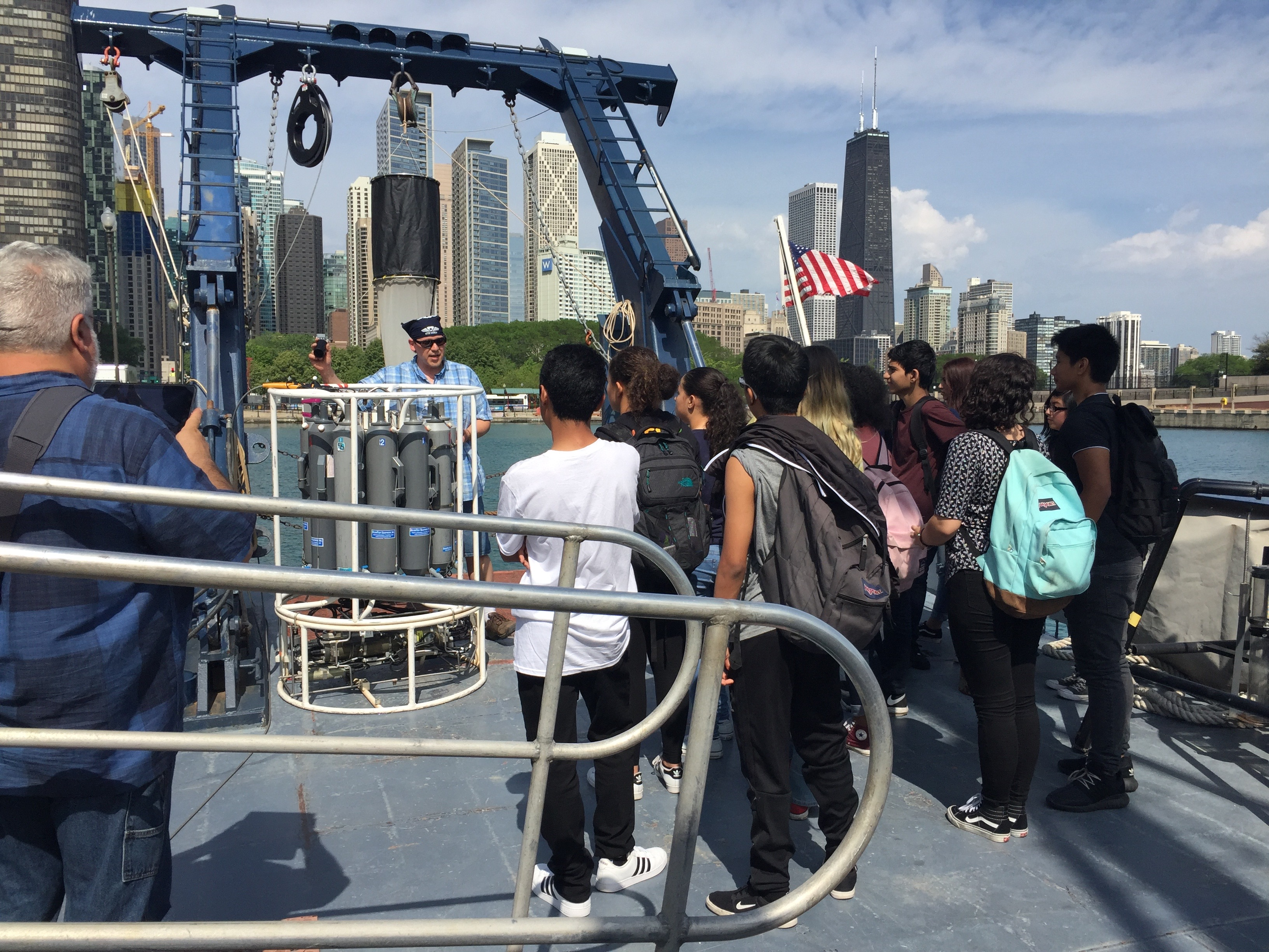 researcher talks to kids on a boat