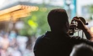 musician playing trumpet on outdoor stage