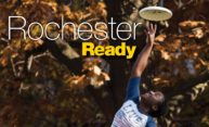 student catching a frisbee; title says ROCHESTER READY