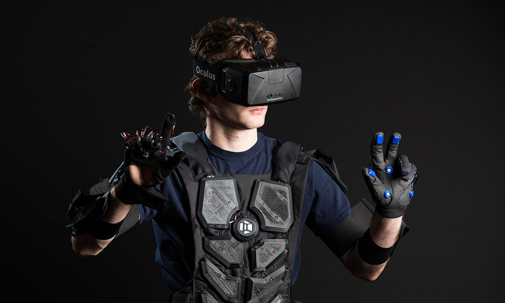man wearing a virtual reality suit and goggles