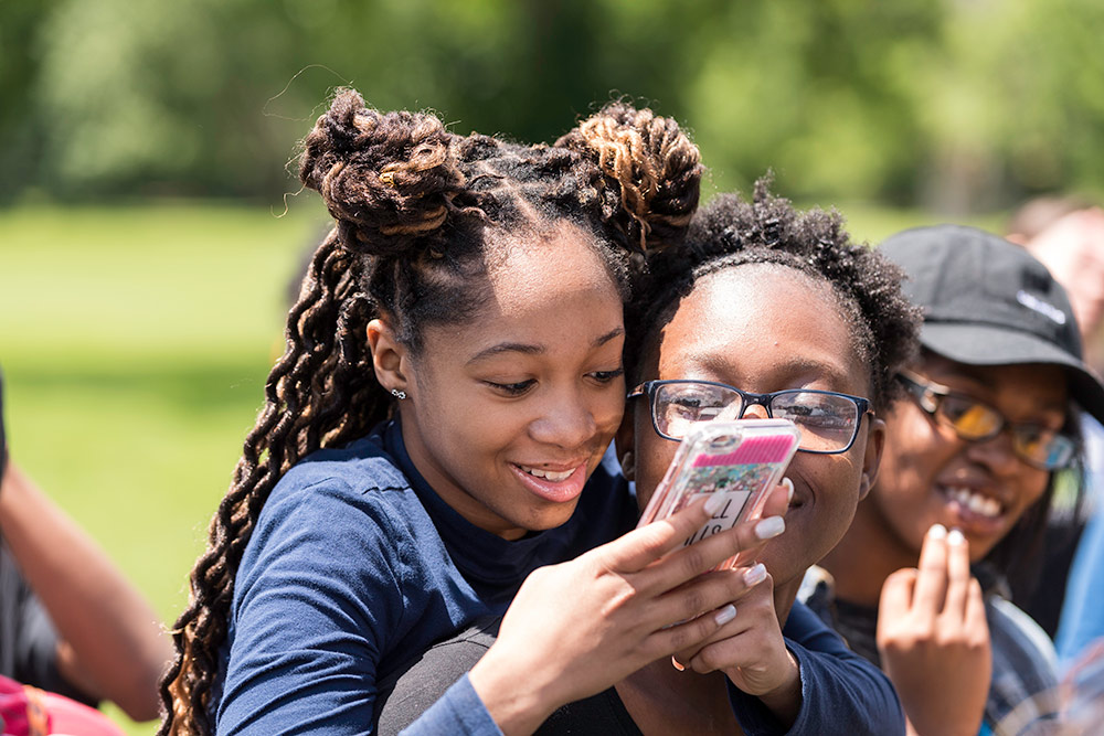 two students on cell phones