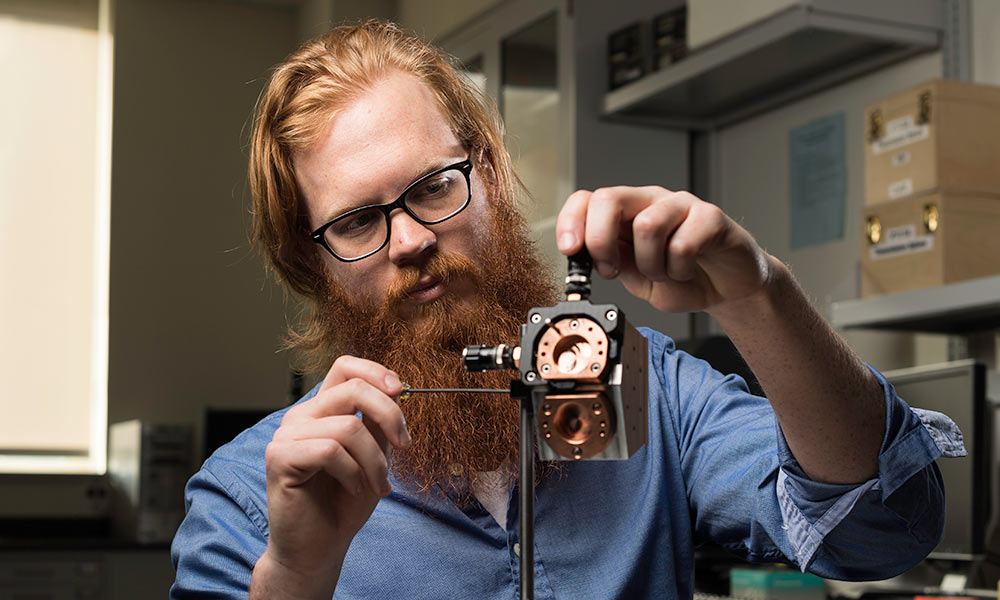 man adjusting metal measuring device