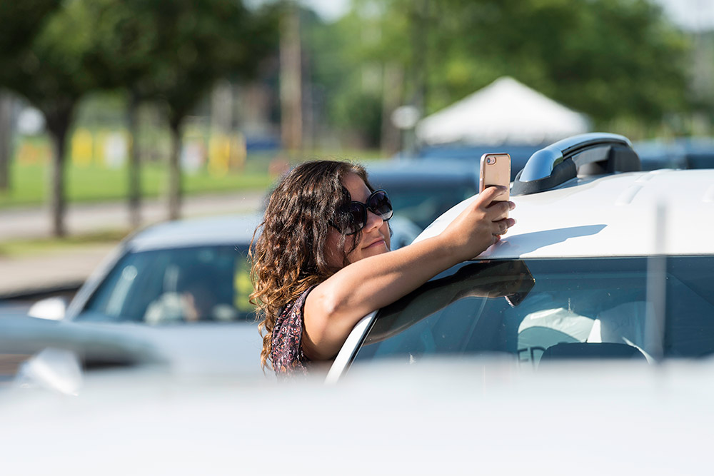 woman taking a photo with iPhone