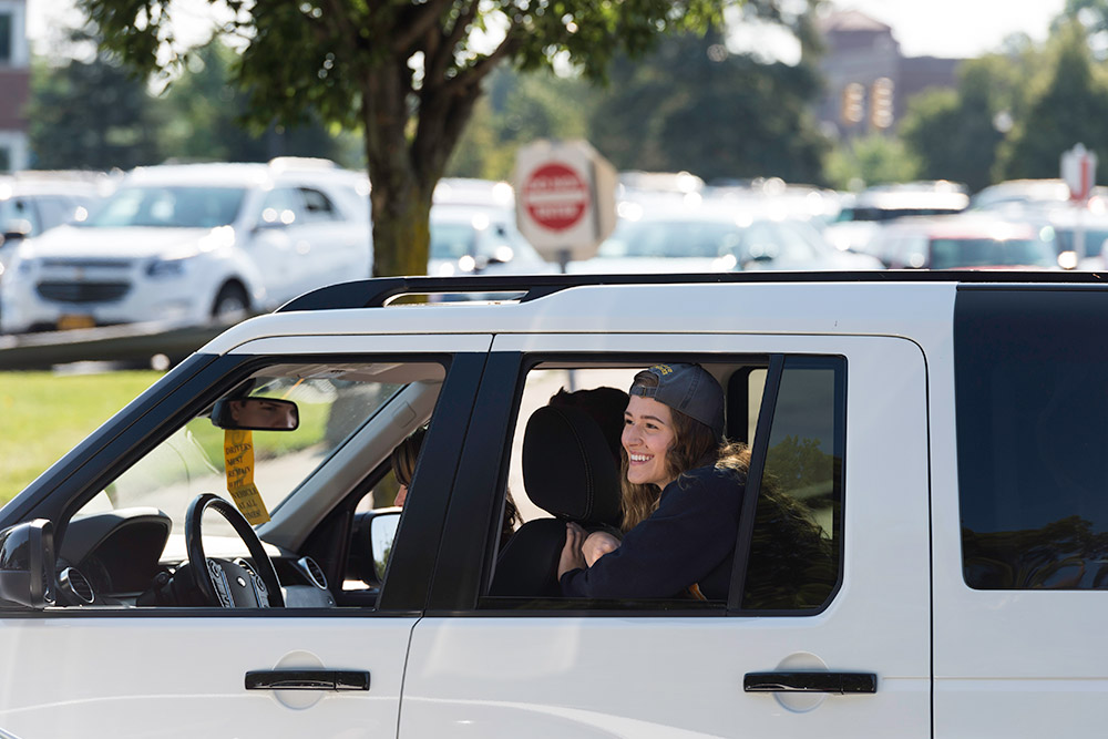smiling student in car
