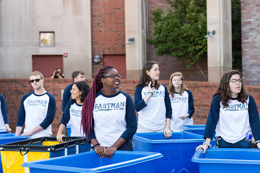 large group of students, each with blue cart
