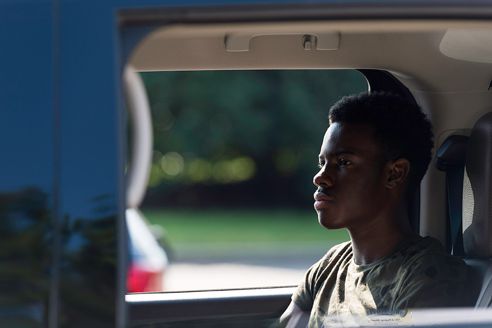 student sitting in car