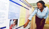 student at a poster presentation of her research results